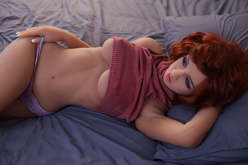 Newest sex doll Eliza is lying on the sofa